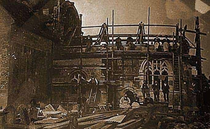 History of Scaffolding -A rare photo of scaffolding workers using wooden poles c1900