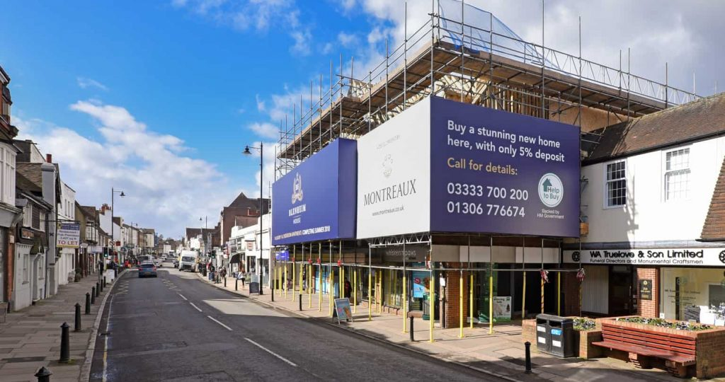 Image of building wrap showing adverts