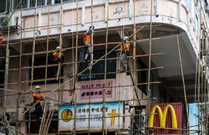 scaffolders erecting bamboo scaffolding in Hong Kong