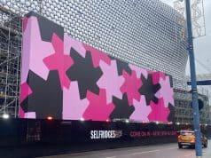 The UK's biggest scaffold wrap installation gets underway.